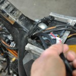 Pulling wiring harness through frame