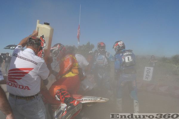 Two Honda teams arrive at pit side by side at the 2011 Baja 500