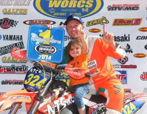 Gary and his daughter Emery celebrate his championship.